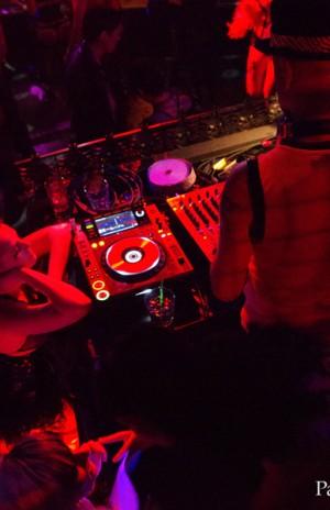 DJ Pandemonium at his post providing the soundtrack for the night's shenanigans ...